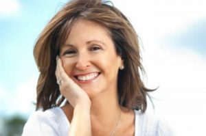 Happy mature woman with perfect teeth. Dental health for adults in Springfield Lorton Dental Group.
