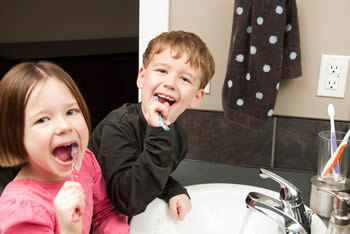 Children brushing their teeth. Dental health for children in Springfield Lorton Dental Group, VA.