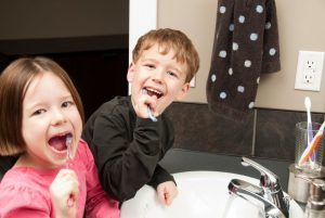 Children brushing their teeth. Dental health for children in Springfield Lorton Dental Group, VA.
